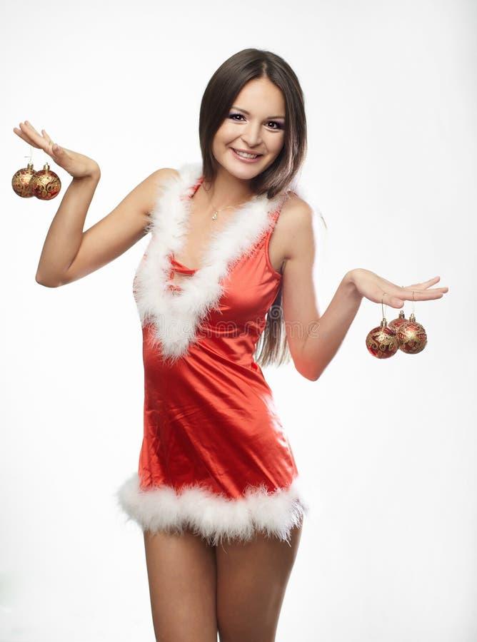 Mooi sexy meisje dat de kleren van de Kerstman draagt royalty-vrije stock foto