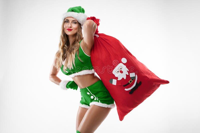 Mooi sexy meisje dat de kleren van de Kerstman draagt royalty-vrije stock foto's