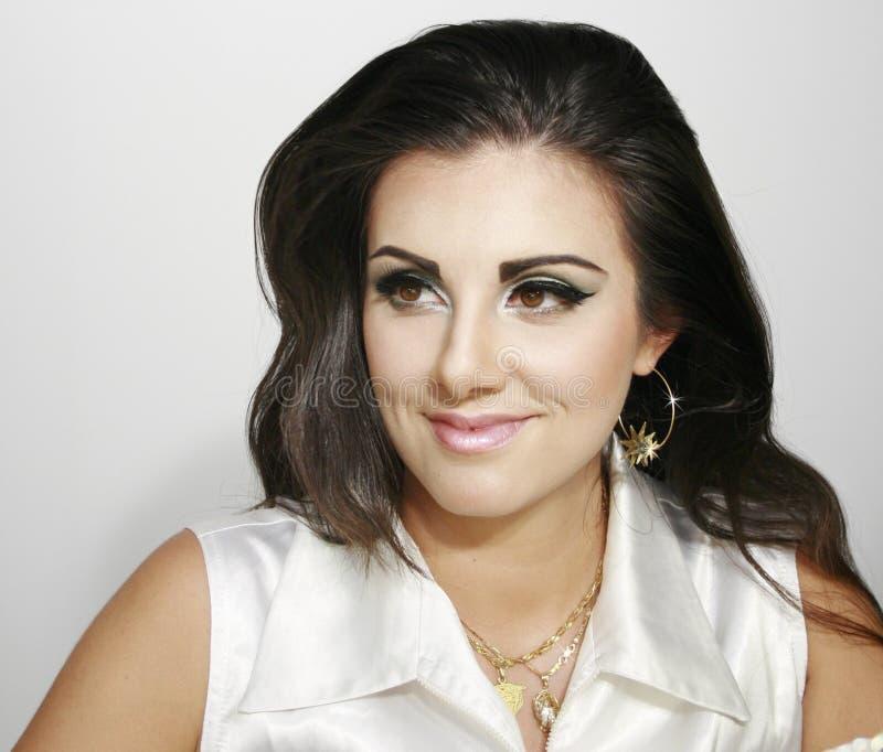 Mooi smileymeisje met make-up stock afbeelding