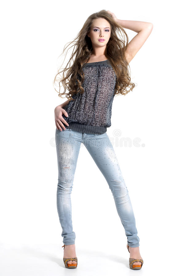 Mooi tienermodel in jeans stock afbeelding