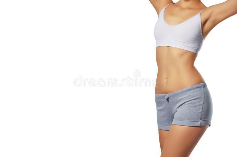 Mooi vrouwenlichaam Perfecte glanzende huid voor de zomer Slanke tanne stock afbeelding