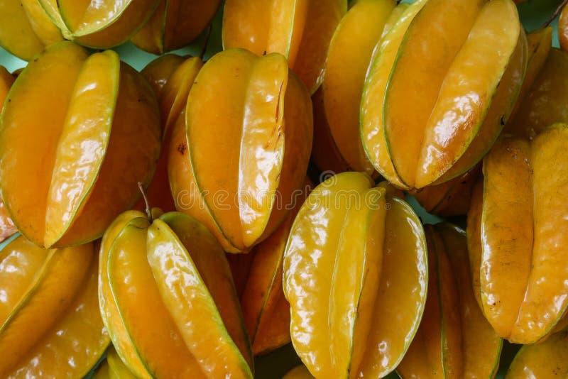 Mooie achtergrond met fruit van de carambola het organische ster stock afbeelding