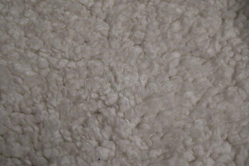 Mooie achtergrond van witte dichte omhooggaand van het schapenbont stock afbeelding