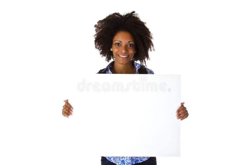 Mooie afro Amerikaanse Vrouw met spatie whiteboard royalty-vrije stock foto