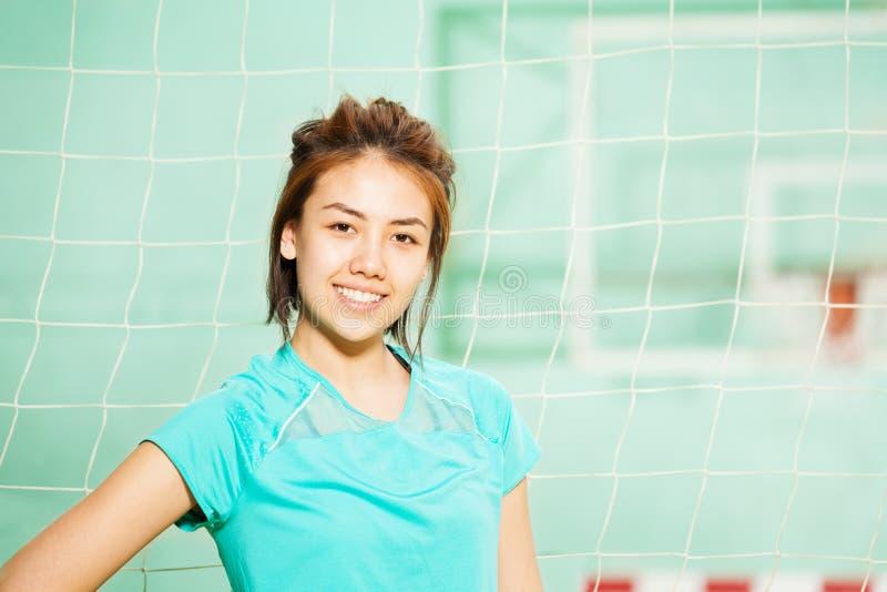 Mooie Aziatische tiener in sportkleding stock fotografie