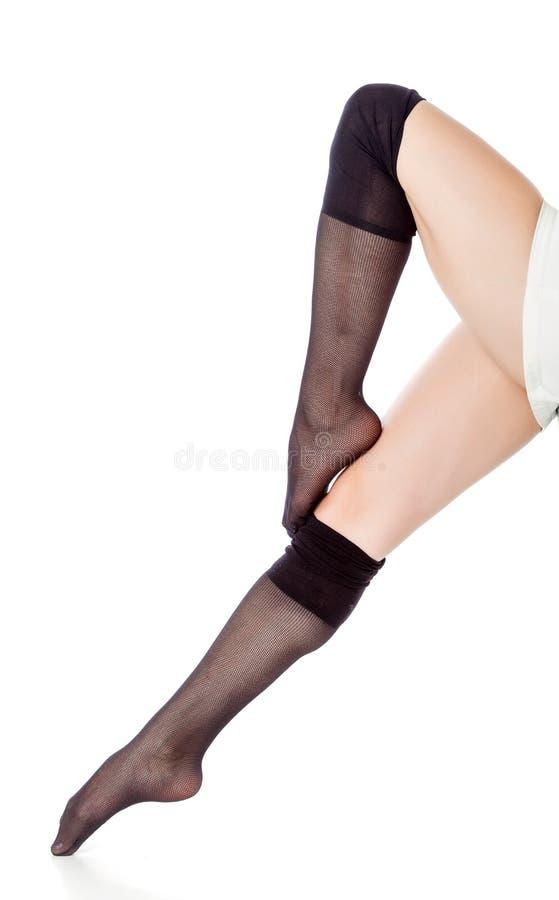 Mooie benen in zwarte kousen stock foto