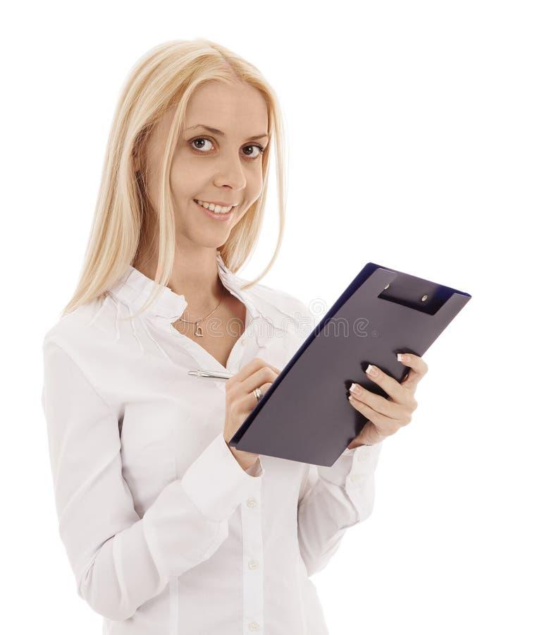Mooie blondemeisje, pen en omslag het glimlachen stock fotografie