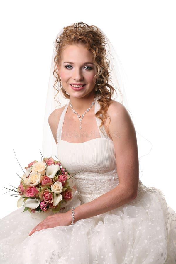 Mooie bruid met sluier stock foto's