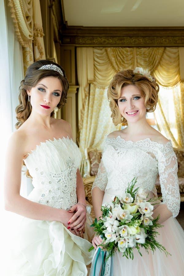 Mooie Bruiden met huwelijksmake-up royalty-vrije stock foto