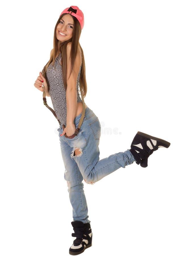 Mooie bruin-haired vrouw in een GLB en jeans royalty-vrije stock foto's