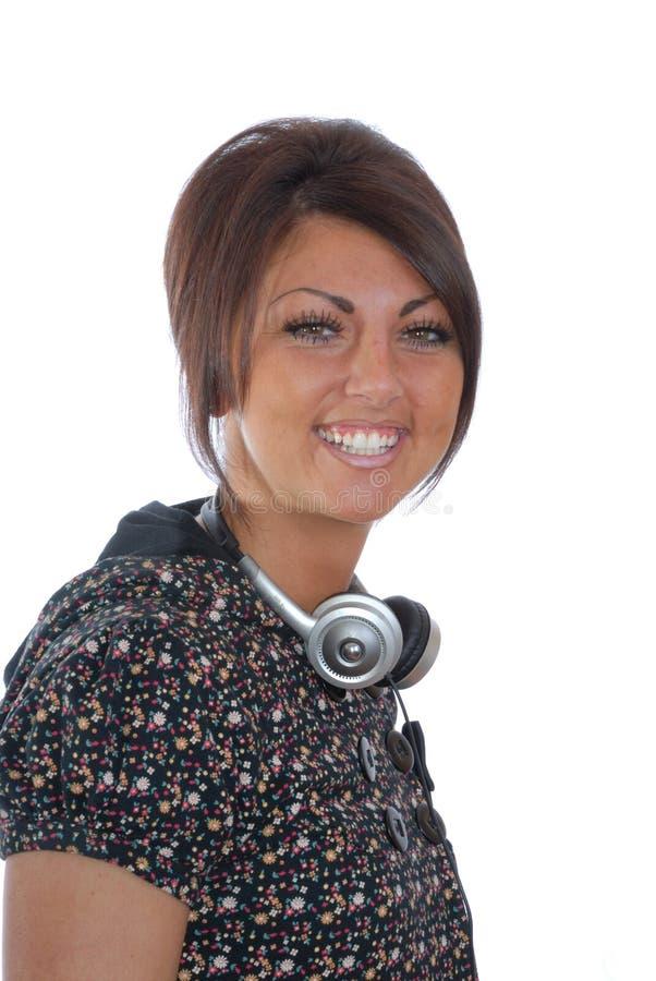 Mooie brunette met hoofdtelefoons royalty-vrije stock foto's