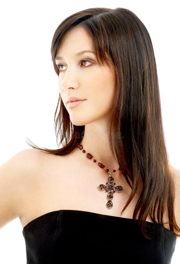 Mooie brunette met kruisbeeld stock afbeeldingen