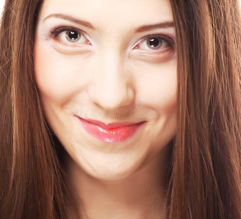 Mooie charmante glimlachende vrouw stock foto's