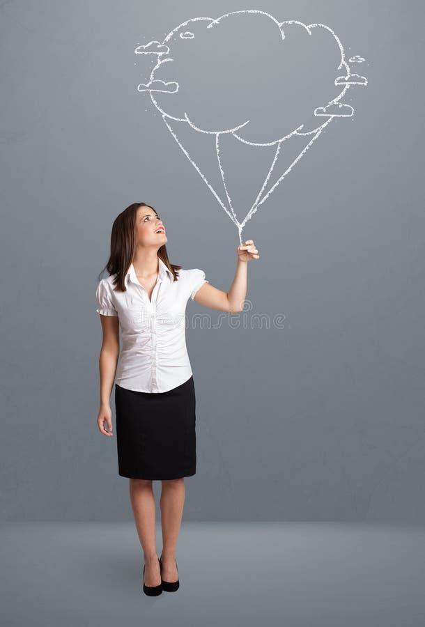 Mooie dame die een tekening van de wolkenballon houden stock afbeelding
