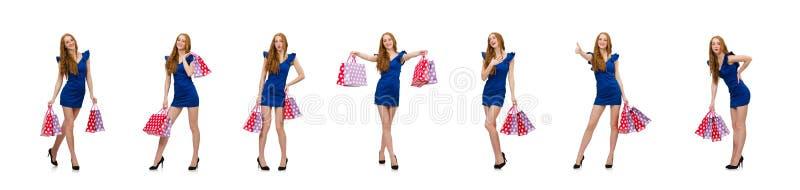 Mooie dame in donkerblauwe kleding die op wit wordt ge?soleerd royalty-vrije stock foto