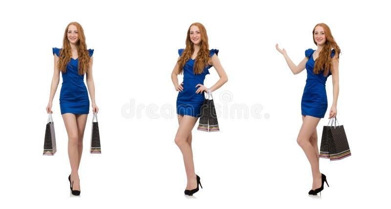 Mooie dame in donkerblauwe kleding die op wit wordt ge?soleerd stock foto