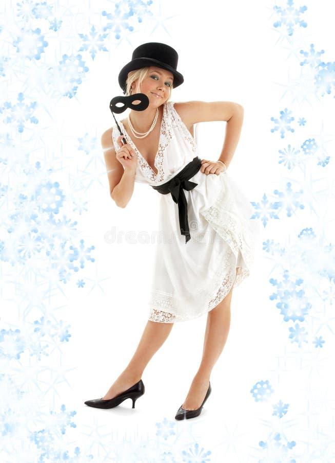 Mooie dame met zwarte masker en sneeuwvlokken stock foto's