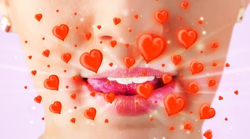 Mooie damelippen met mooie rode harten stock afbeelding