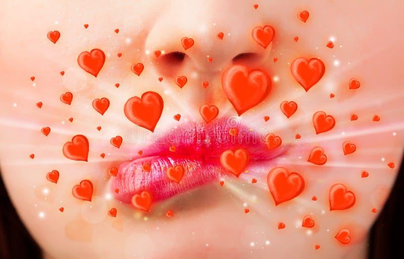 Mooie damelippen met mooie rode harten royalty-vrije stock foto's