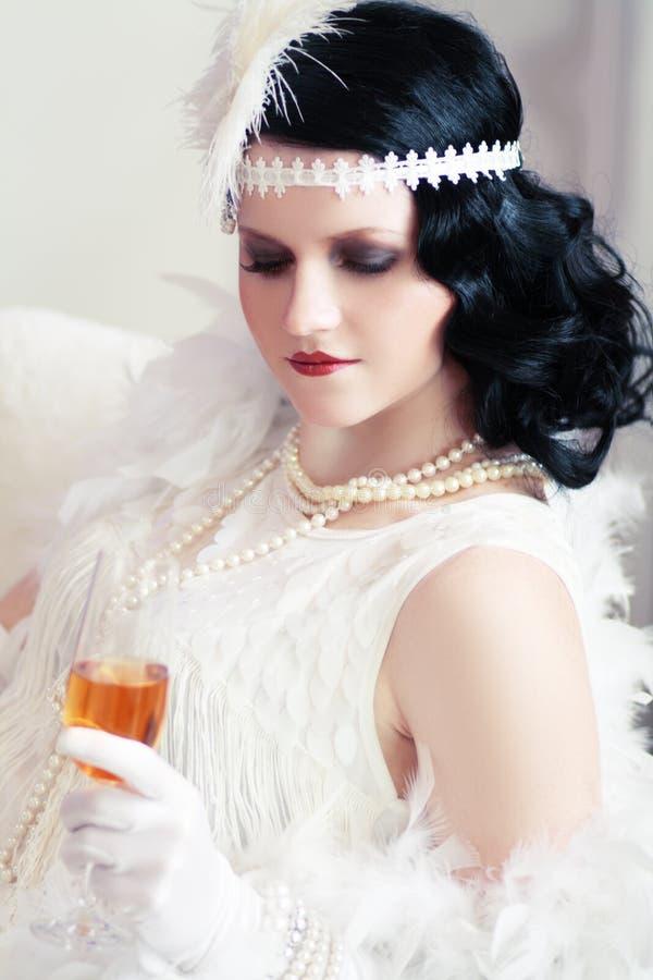 Het drinken van de vrouw champagne stock fotografie
