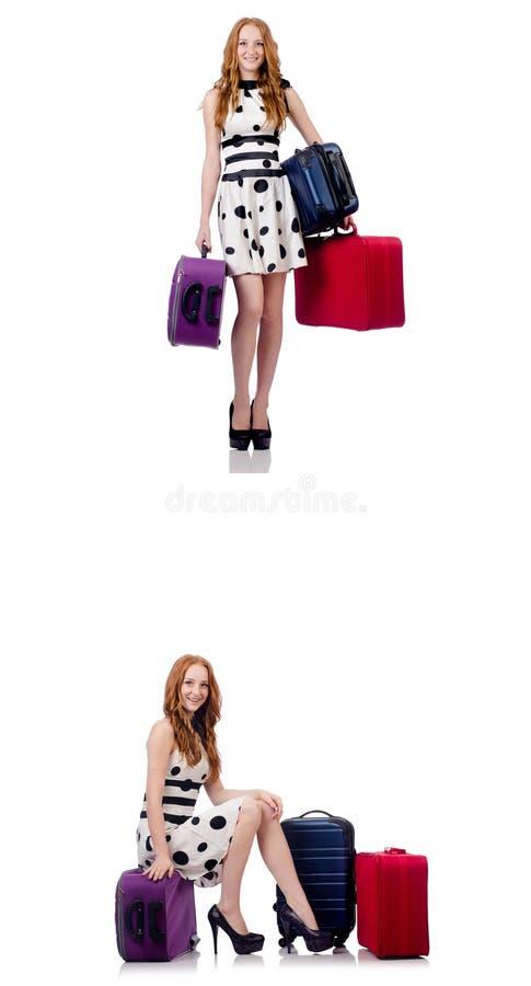 Mooie die vrouw in stipkleding met koffers op wh wordt ge?soleerd royalty-vrije stock fotografie