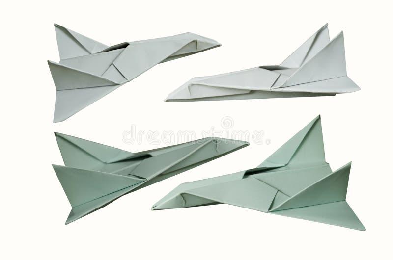 Mooie document vliegtuigen op witte achtergrond stock foto's