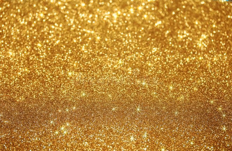 Mooie feestelijke glanzende Gouden achtergrond van heldere vonken en s royalty-vrije stock fotografie