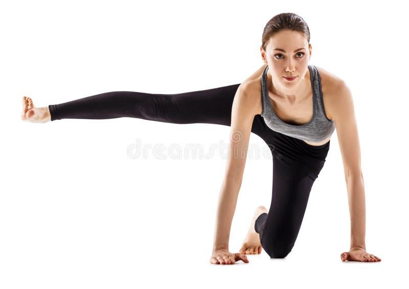 Mooie flexibele vrouw die yogaoefening doen royalty-vrije stock afbeeldingen