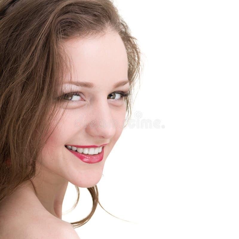 Mooie flirt jonge die vrouw, op wit wordt geïsoleerd stock foto