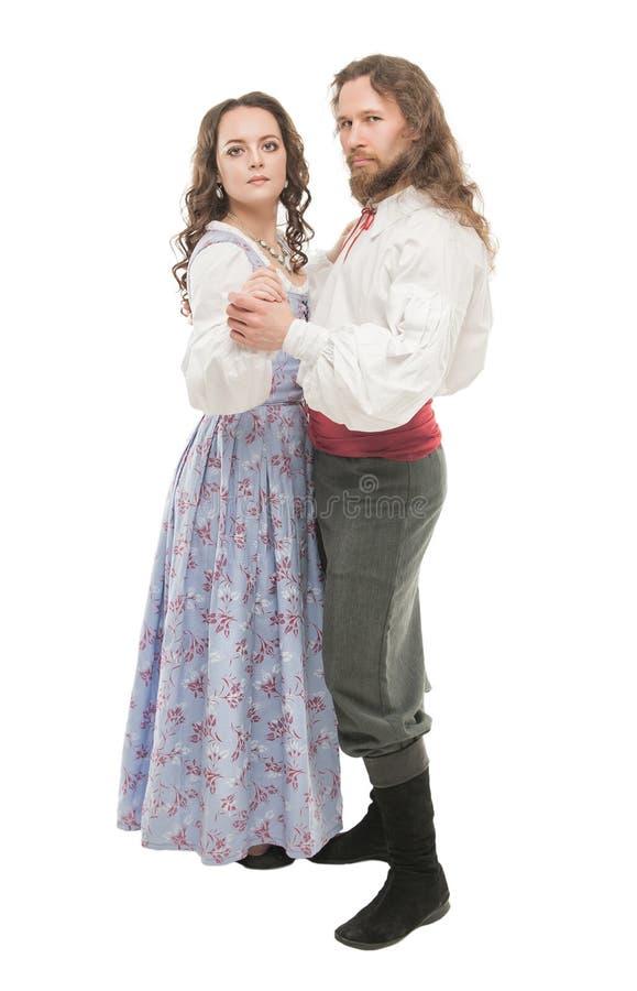 Mooie geïsoleerde paarvrouw en man in middeleeuwse kleren royalty-vrije stock afbeeldingen