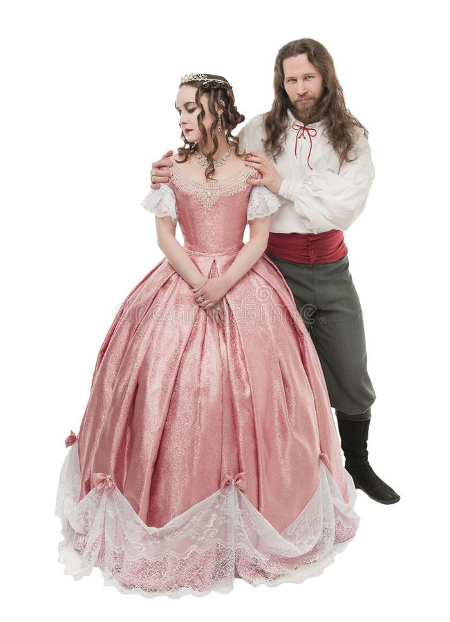 Mooie ge?soleerde paarvrouw en man in middeleeuwse kleren stock foto