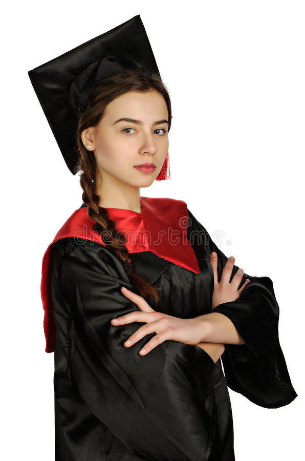 Mooie gediplomeerde studente in mantel stock afbeelding