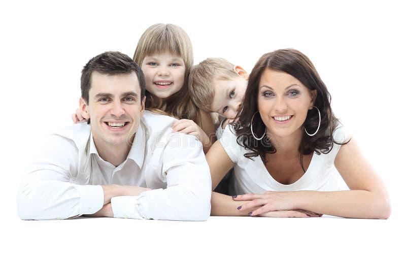 Mooie gelukkige die familie - over een witte achtergrond wordt geïsoleerd royalty-vrije stock afbeeldingen