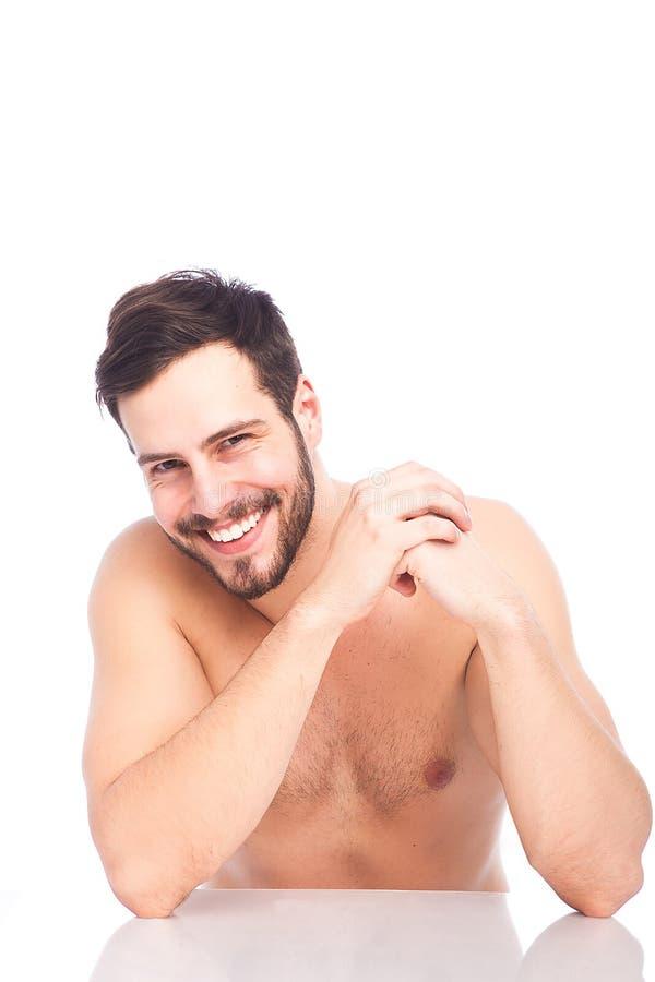 Mooie glimlach van een mens zonder overhemd stock fotografie