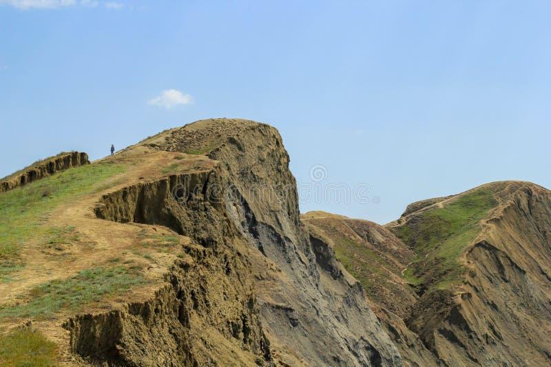 Mooie heuvel met een mens stock afbeeldingen