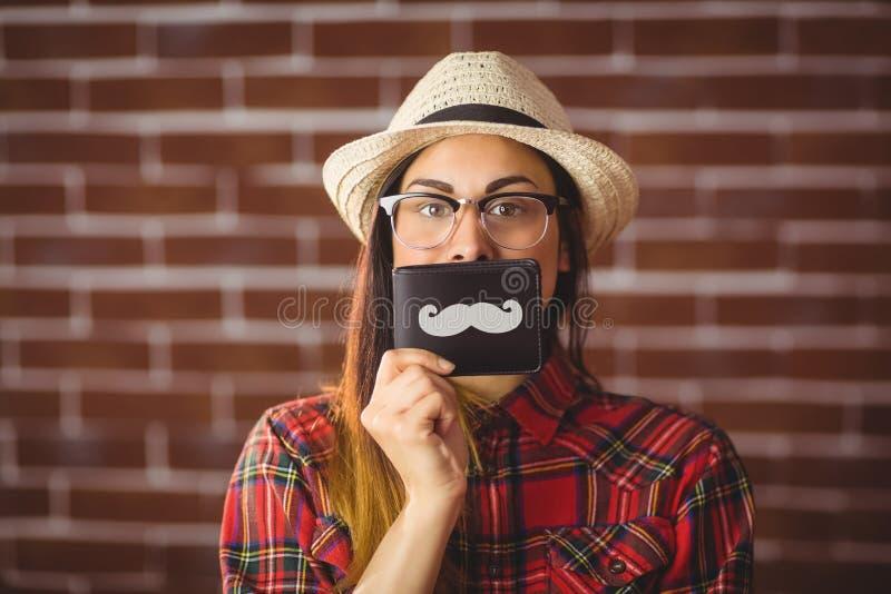 Mooie hipster met snor op portefeuille royalty-vrije stock afbeeldingen