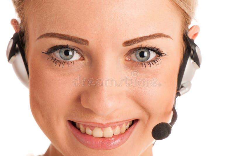 Mooie jonge bedrijfsvrouw met hoofdtelefoon royalty-vrije stock foto
