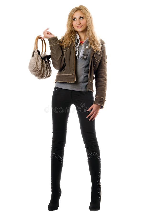 Mooie jonge blonde met een handtas royalty-vrije stock foto