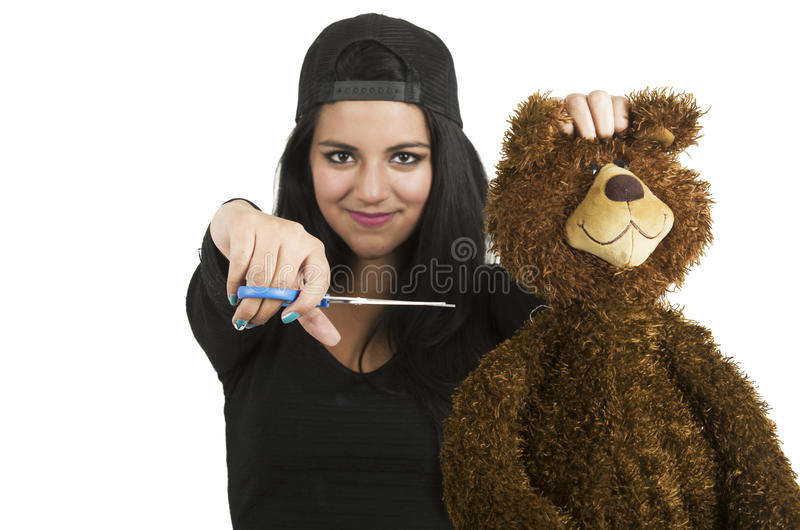 Mooie jonge donkerbruine klaar om teddybeer te snijden royalty-vrije stock foto