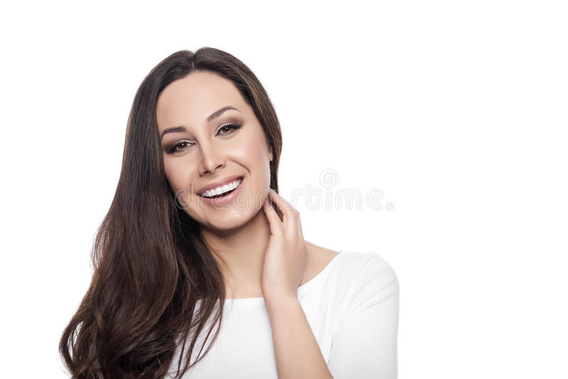 Mooie jonge gelukkige glimlachende vrouw stock foto