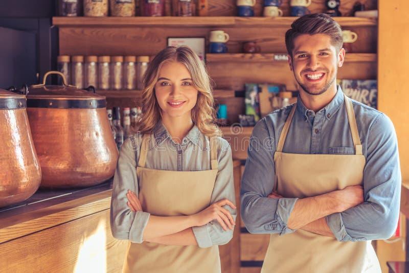 Mooie jonge kelners royalty-vrije stock afbeelding