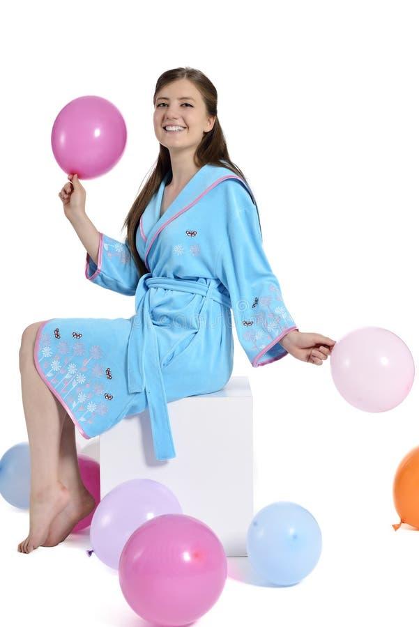 Mooie jonge vrouw in badjas stock foto's