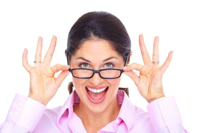 Mooie jonge vrouw die glazenportret dragen. stock foto