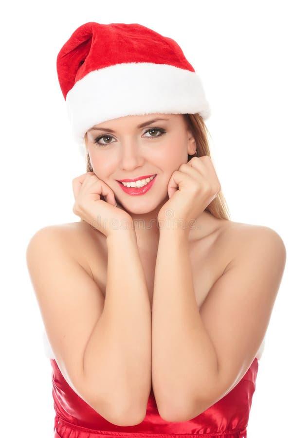 Mooie jonge vrouw die in rood santahoed draagt. stock afbeelding