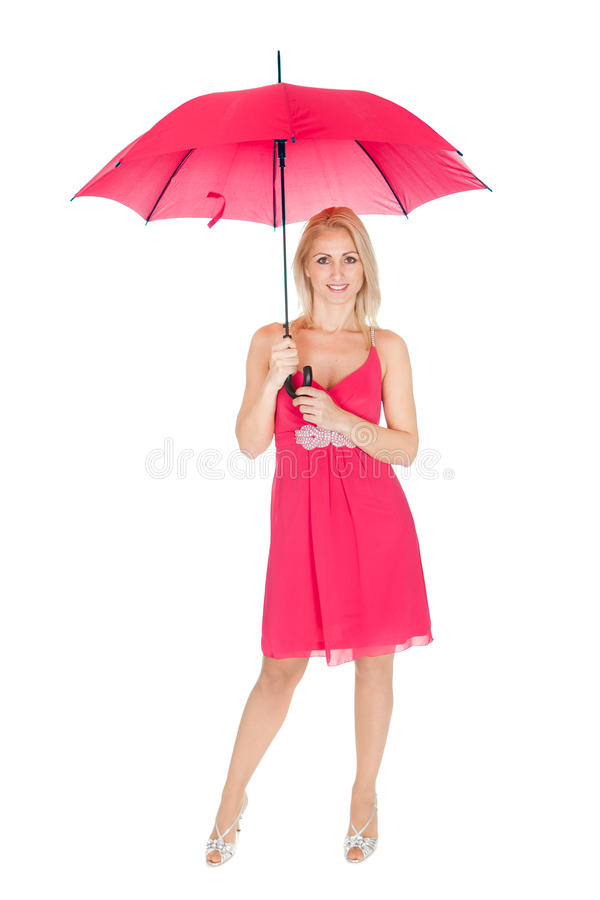 Mooie jonge vrouw die zich met paraplu bevindt stock foto's