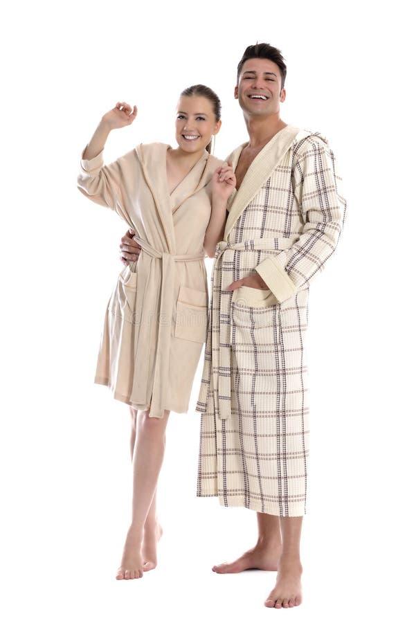 Mooie jonge vrouw en man in badjas stock foto's