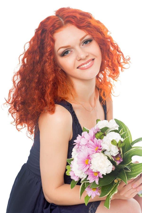 Mooie jonge vrouw met bloemen royalty-vrije stock foto