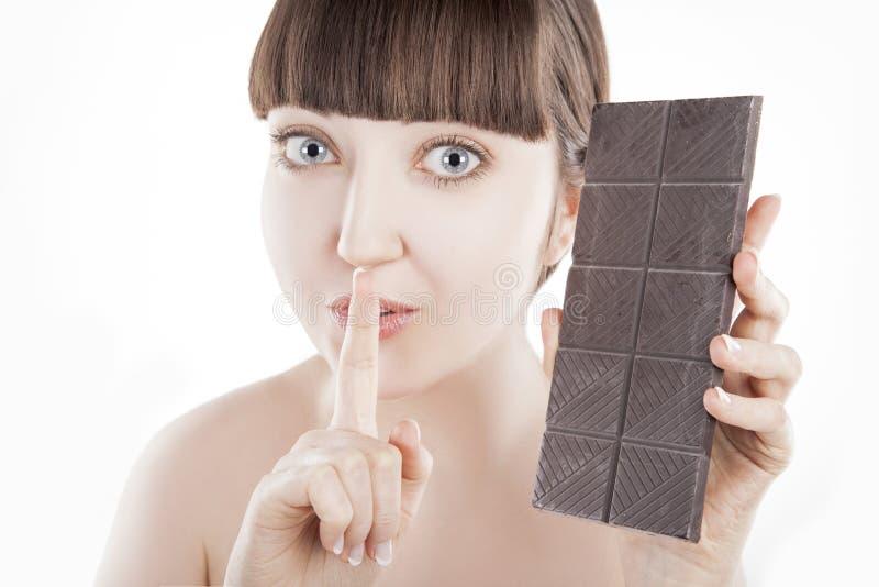 Mooie jonge vrouw met een grote chocoladereep - (Reeks) royalty-vrije stock afbeeldingen