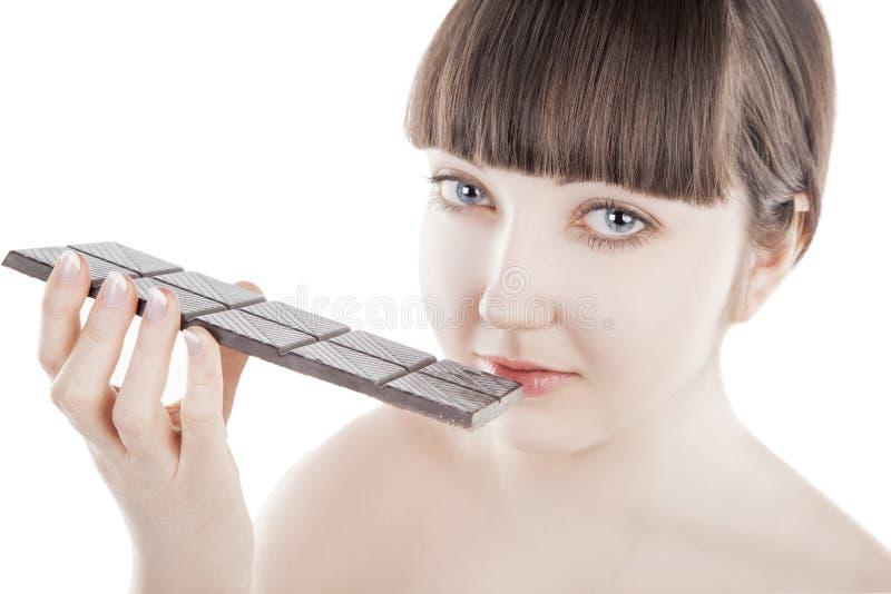 Mooie jonge vrouw met een grote chocoladereep - (Reeks) royalty-vrije stock fotografie