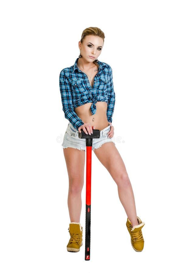 Mooie jonge vrouw met een hamer royalty-vrije stock foto's